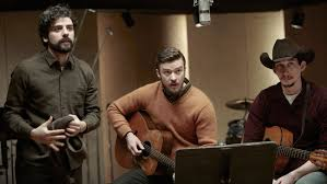 Isaac as Davis, Timberlake as Jim, and Adam Brody as Al Cody in the studio session scene