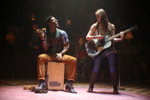 "James Williams and Laura Dreyfuss ""playing"" the guitar (photo Joan Marcus)"