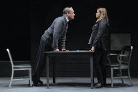 Frank Wood as Sims and Merritt Wever as Morris, debating the real